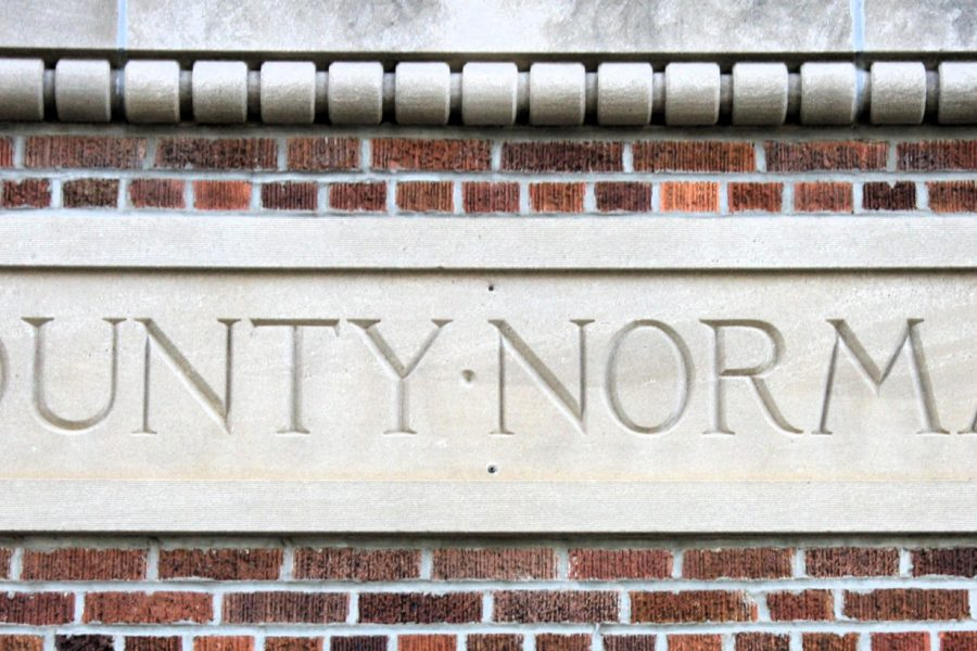 'County Normal' carved in stone